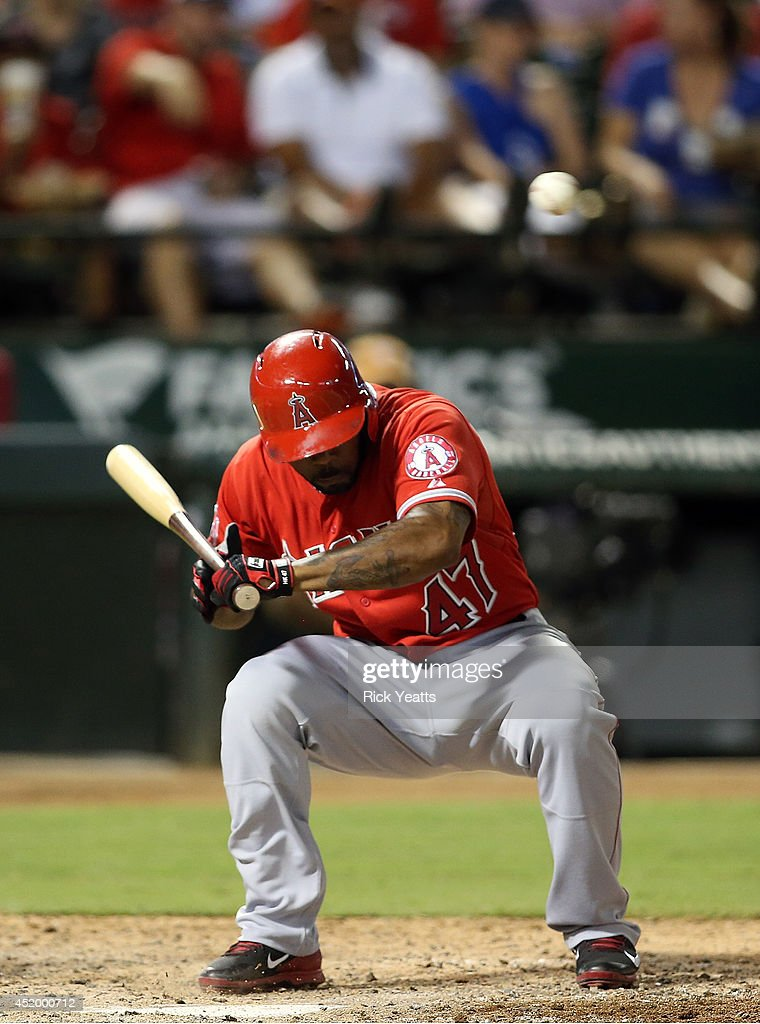 <a gi-track='captionPersonalityLinkClicked' href=/galleries/search?phrase=Howie+Kendrick&family=editorial&specificpeople=628938 ng-click='$event.stopPropagation()'>Howie Kendrick</a> #47 of the Los Angeles Angels of Anaheim ducks to avoid a wild pitch in the sixth inning from Matt West #63 of the Texas Rangers at Globe Life Park in Arlington on July 10, 2014 in Arlington, Texas.