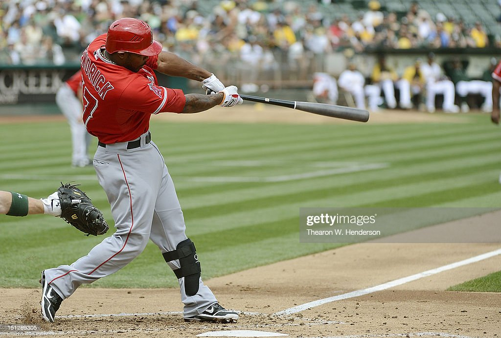 <a gi-track='captionPersonalityLinkClicked' href=/galleries/search?phrase=Howie+Kendrick&family=editorial&specificpeople=628938 ng-click='$event.stopPropagation()'>Howie Kendrick</a> #47 of the Los Angeles Angels of Anaheim hits a two run single with the bases loaded in the third inning against the Oakland Athletics at O.co Coliseum on September 5, 2012 in Oakland, California.
