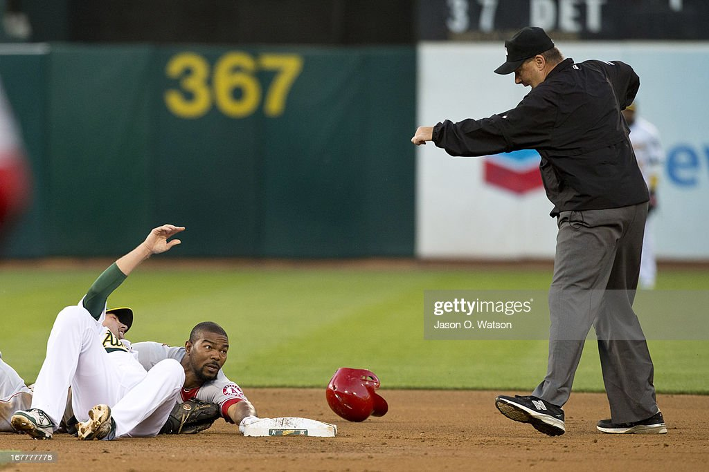 Howie Kendrick #47 of the Los Angeles Angels of Anaheim is called out by umpire Gary Cederstrom #38 after getting tagged out at second base by Jed Lowrie #8 of the Oakland Athletics during the second inning at O.co Coliseum on April 29, 2013 in Oakland, California.