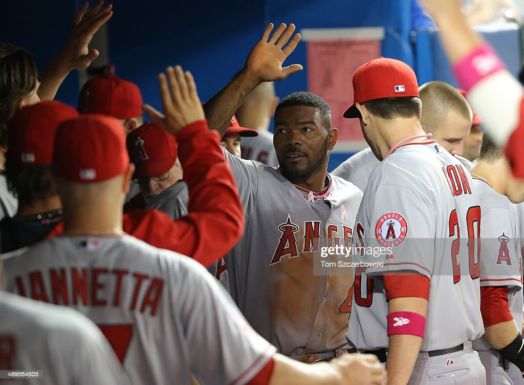 <a gi-track='captionPersonalityLinkClicked' href=/galleries/search?phrase=Howie+Kendrick&family=editorial&specificpeople=628938 ng-click='$event.stopPropagation()'>Howie Kendrick</a> #47 of the Los Angeles Angels of Anaheim is congratulated by teammates in the dugout after scoring a run in the fourth inning during MLB game action against the Toronto Blue Jays on May 11, 2014 at Rogers Centre in Toronto, Ontario, Canada.
