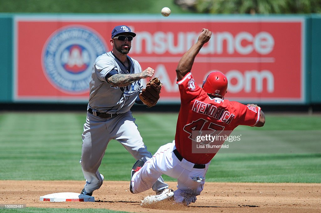 <a gi-track='captionPersonalityLinkClicked' href=/galleries/search?phrase=Howie+Kendrick&family=editorial&specificpeople=628938 ng-click='$event.stopPropagation()'>Howie Kendrick</a> #47 of the Los Angeles Angels of Anaheim is out at second base in the second inning against Ryan Roberts #19 of the Tampa Bay Rays at Angel Stadium of Anaheim on August 19, 2012 in Anaheim, California.