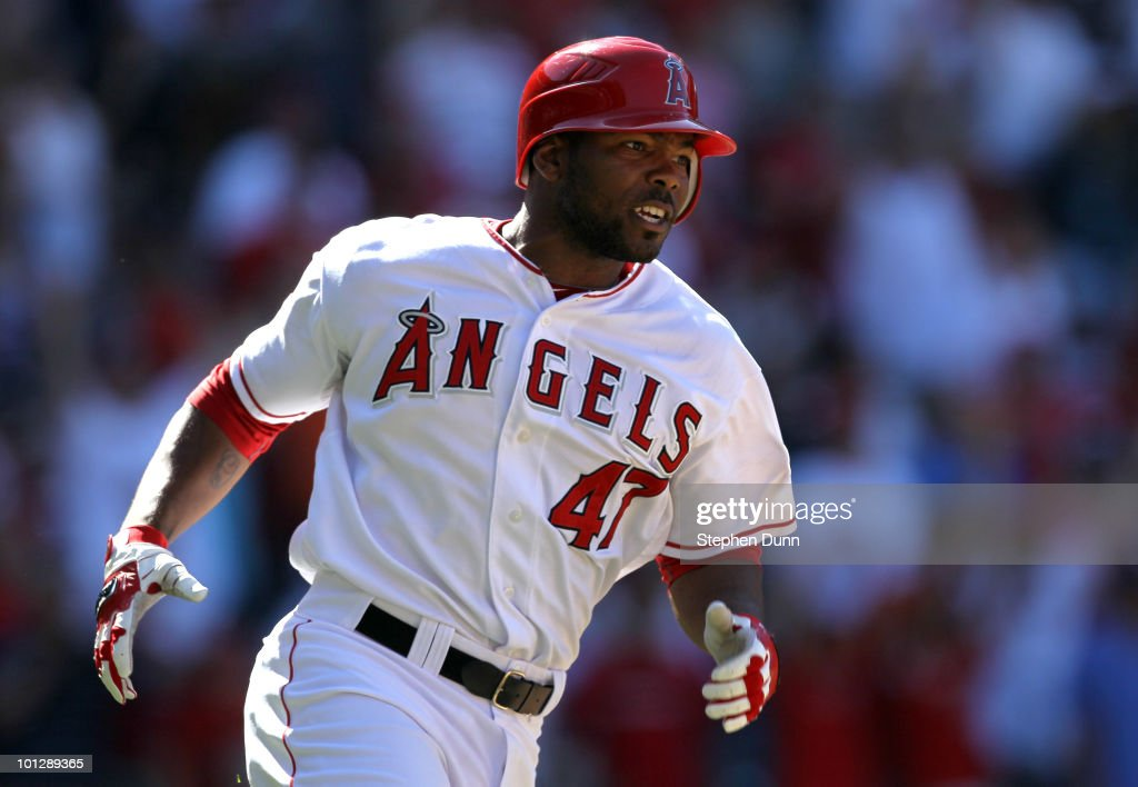 Howie Kendrick #47 of the Los Angeles Angels of Anaheim reacts as he rounds first base after hitting a three run walk off home run in the ninth inning against the Seattle Mariners on May 30, 2010 at Angel Stadium in Anaheim, California. The Angels won 9-7.