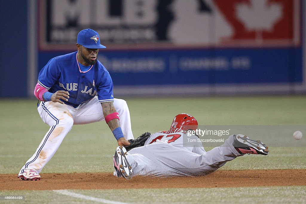 <a gi-track='captionPersonalityLinkClicked' href=/galleries/search?phrase=Howie+Kendrick&family=editorial&specificpeople=628938 ng-click='$event.stopPropagation()'>Howie Kendrick</a> #47 of the Los Angeles Angels of Anaheim steals second base in the fourth inning during MLB game action as Jose Reyes #7 of the Toronto Blue Jays cannot handle the throw on May 11, 2014 at Rogers Centre in Toronto, Ontario, Canada.