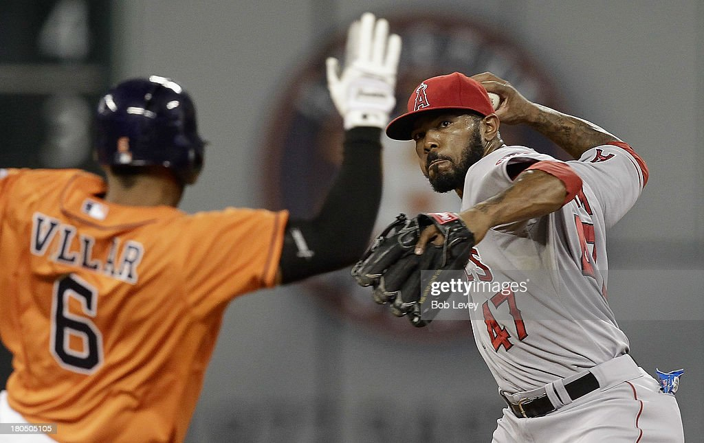 <a gi-track='captionPersonalityLinkClicked' href=/galleries/search?phrase=Howie+Kendrick&family=editorial&specificpeople=628938 ng-click='$event.stopPropagation()'>Howie Kendrick</a> #47 of the Los Angeles Angels of Anaheim throws to first base to complete a double play as Jonathan Villar #6 of the Houston Astros slides into second base at Minute Maid Park on September 13, 2013 in Houston, Texas.