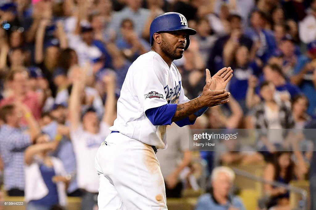 Howie Kendrick #47 of the Los Angeles Dodgers celebrates after he scores in the fourth inning against the Chicago Cubs in game five of the National League Division Series at Dodger Stadium on October 20, 2016 in Los Angeles, California.