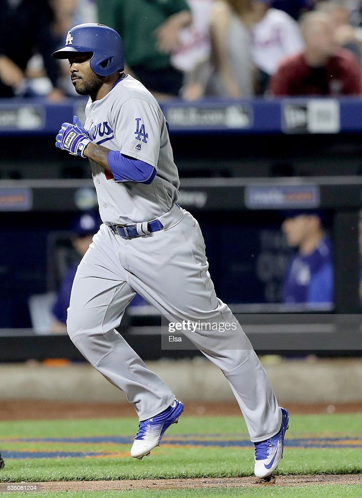 Howie Kendrick #47 of the Los Angeles Dodgers heads for home after hitting a solo home run in the eighth inning against the New York Mets at Citi Field on May 28, 2016 in the Flushing neighborhood of the Queens borough of New York City.