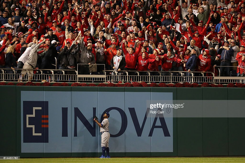 Howie Kendrick #47 of the Los Angeles Dodgers watches a two run home run hit by Chris Heisey #14 of the Washington Nationals (not pictured) in the seventh inning during game five of the National League Division Series at Nationals Park on October 13, 2016 in Washington, DC.