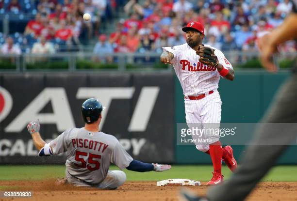 Howie Kendrick of the Philadelphia Phillies forces out Stephen Piscotty of the St Louis Cardinals at second base in the third inning during a game at...
