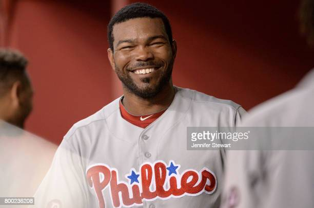 Howie Kendrick of the Philadelphia Phillies smiles in the dugout during the ninth inning of the MLB game against the Arizona Diamondbacks at Chase...