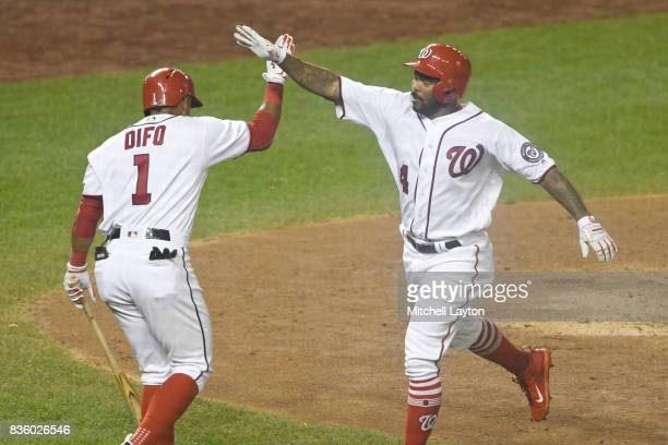 Howie Kendrick of the Washington Nationals celebrates a home run with Wilmer Difo during a baseball game against the Los Angeles Angels of Anaheim at...