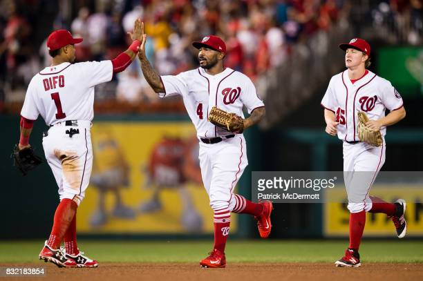 Howie Kendrick of the Washington Nationals celebrates with Wilmer Difo after the Nationals defeated the Los Angeles Angels of Anaheim 31 at Nationals...