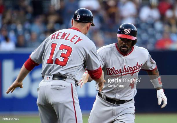 Howie Kendrick of the Washington Nationals is congratulated by Bob Henley after hitting a solo home run during the first inning of a baseball game...