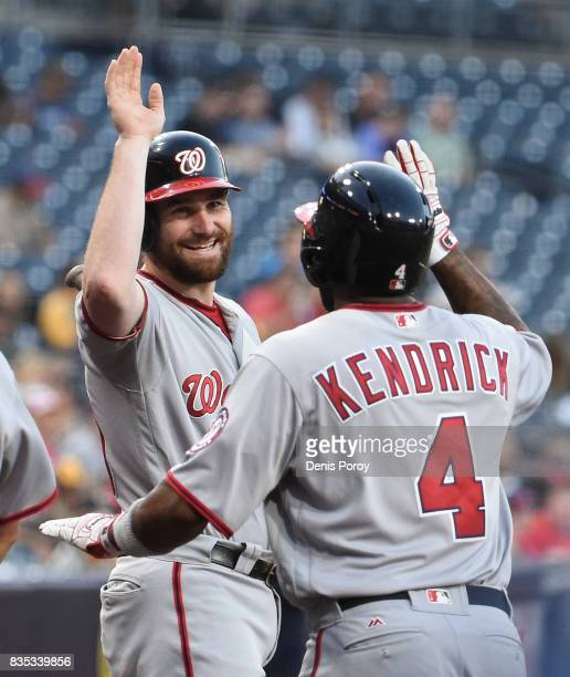 Howie Kendrick of the Washington Nationals is congratulated by Daniel Murphy after hitting a solo home run during the first inning of a baseball game...