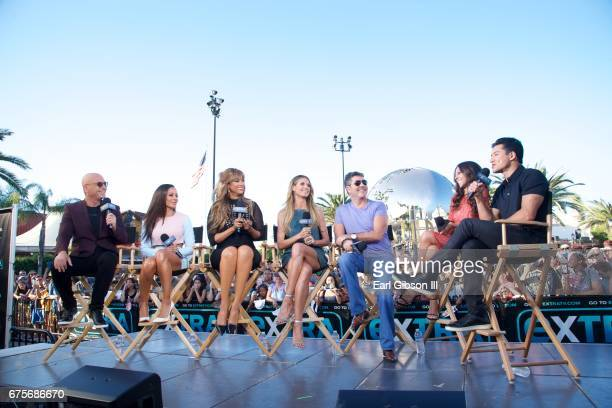 Howie Mandel Mel B Tyra Banks Heidi Klum Simon Cowell Terri Seymour and Mario Lopez speak on stage at 'Extra' at Universal Studios Hollywood on May 1...