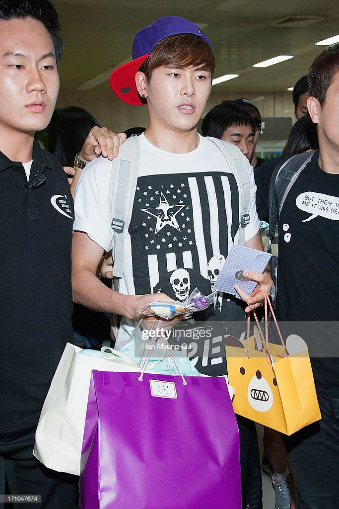 Hoya of South Korean boy band Infinite is seen upon arrival at Gimpo International Airport on June 21, 2013 in Seoul, South Korea.