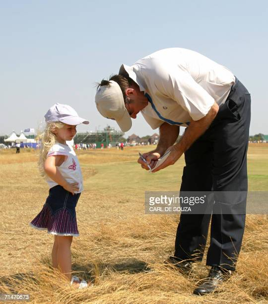 England's Nick Faldo signs an autograph for a young fan after a practice session at the British Open Golf Championships in Hoylake in Liverpool...