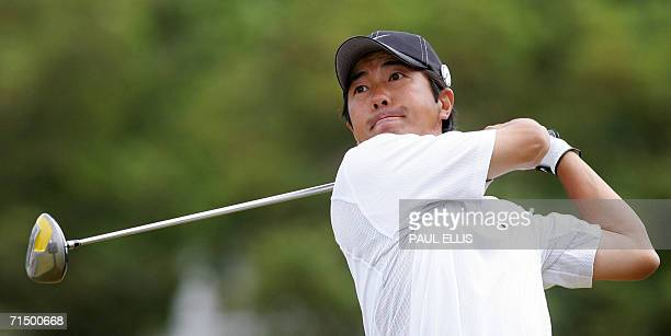 Keiichero Fukabori of Japan strikes the ball from the fourth tee as he plays in the third round of the 135th British Open Golf Championships in...