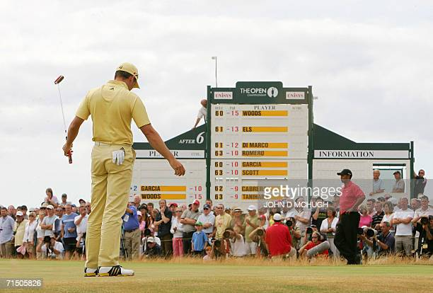Spain's Segio Garcia gestures as he partners Tiger Woods of the United States on the 8th green in the fourth round of the 135th British Open Golf...