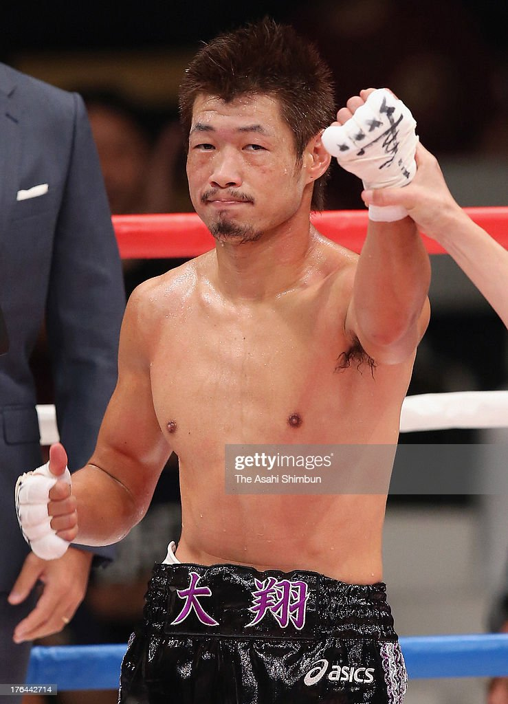Hozumi Hasegawa of Japan celebrates winning after scoring a 1st round knockout over Genaro Camargo of Mexico in a non-title match at the Ota-City General Gymnasiumon on August 12, 2013 in Tokyo, Japan.