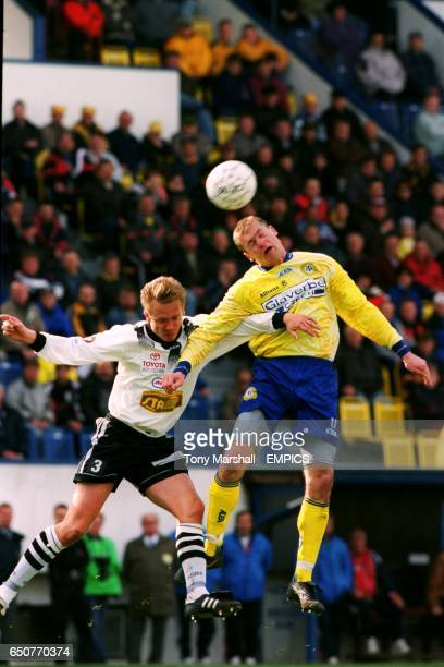 Hradec Kralove's David Homolac battles for the ball in the air with FK Teplice's Radek Divecky