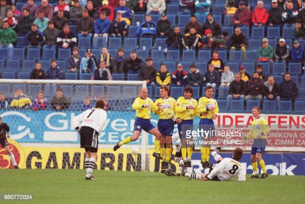 SK Hradec Kralove's Jaroslav Dvorak curls a freekick under the defensive wall