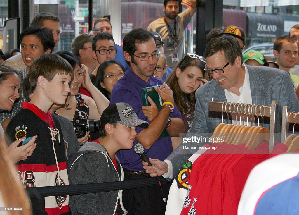 EJ Hradek of NHL Studios USA lets a young fan pose a question to <a gi-track='captionPersonalityLinkClicked' href=/galleries/search?phrase=Matt+Moulson&family=editorial&specificpeople=3365493 ng-click='$event.stopPropagation()'>Matt Moulson</a> #26 of the New York Islanders and Patrick Sharp #26 of the Chicago Blackhawks as they are interviewed live in front of fans at the NHL Store Powered by Reebok on September 5, 2013 in New York City.