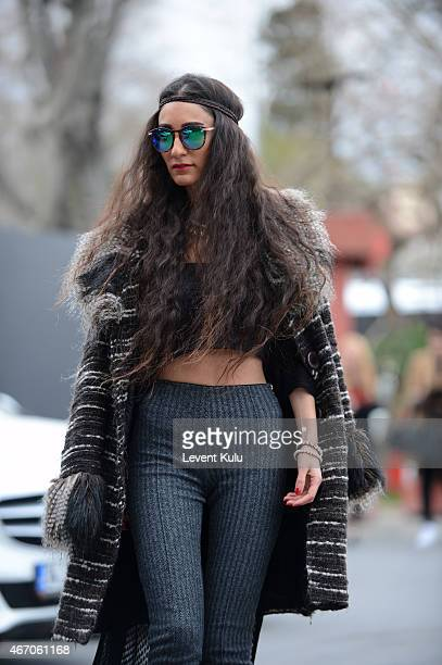 Hrebrena Miroslav poses wearing jacket by Zara pants by Rio Miroslav charm by Koton and sunglasses by Ray Ban during Mercedes Benz Fashion Week...