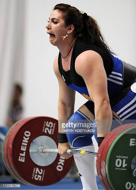 Hripsime Khurshudyan of Armenia lifts weights during the women's 75kg weightlifting finals at the 90th Men's and 24th Women's European Senior...