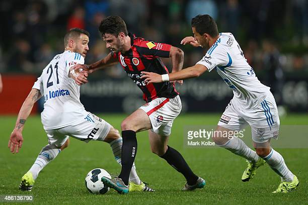 Hristijan Tanoski of the Suns takes the ball past Carl Valeri and Daniel Georgievski of the Victory during the FFA Cup Round of 16 match between...