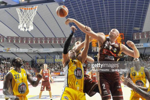 Hrvoje Peric and Gediminas Orelik of Umana competes with Lamar Patterson and Valerio Mazzola and Trevor Mbakwe of Fiat during the LBA LegaBasket of...