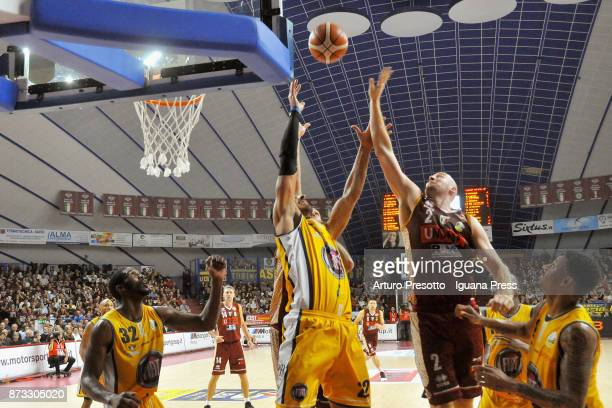 Hrvoje Peric of Umana competes with Lamar Patterson and Valerio Mazzola and Trevor Mbakwe of Fiat during the LBA LegaBasket of Serie A match between...