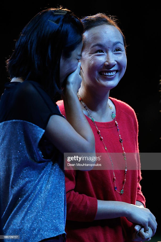 Hsieh Su-Wei of Taiwan and Peng Shuai of China laugh as they watch themselves on the big screen prior to the Doubles Draw during day three of the TEB BNP Paribas WTA Championships at the Sinan Erdem Dome October 24, 2013 in Istanbul, Turkey.