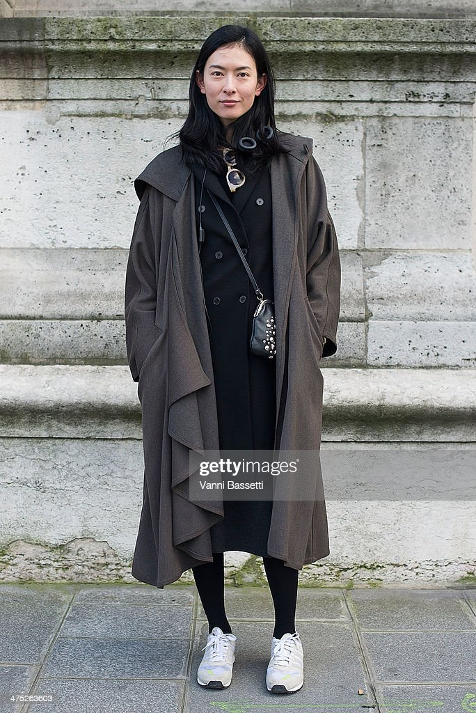 Hsin Yu poses wearing a Zara coat and Adidas trainers before Yang Li show on Day 2 of Paris Collections Womenswear Fall/Winter 2014-2015 at Palais des Beaux Arts on February 26, 2014 in Paris, France.
