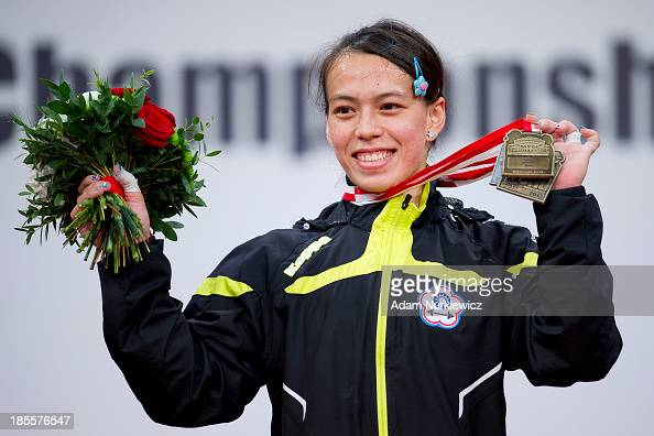 Hsing Chun Kuo from Taipei poses with the gold medal in total competition women's 58 kg Group A during the medal ceremony during the IWF World...