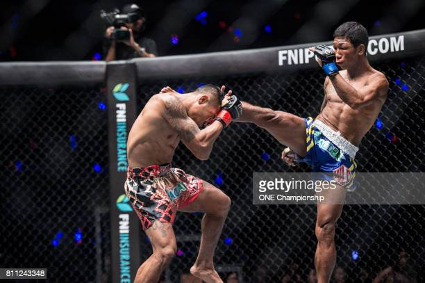 Htet Aung Oo throws a kick against Tha Pyay Nyo during ONE Championship Light Of A Nation at the Thuwunna Indoor Stadium on June 30 2017 in Yangon...