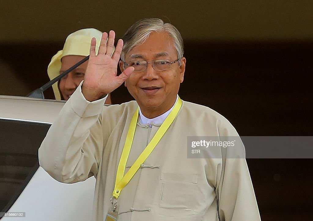 Htin Kyaw newly elected president of Myanmar and member of the National League for Democracy party leaves after a parliament session in Naypyidaw on...