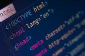 Html header markup, tags, macro on dark-blue background, pixels on image