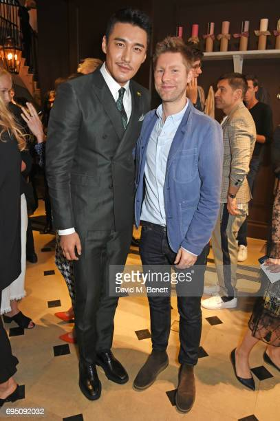 Hu Bing and Christopher Bailey attend a breakfast hosted by Christopher Bailey Dame Natalie Massenet and Dylan Jones in celebration of London Fashion...