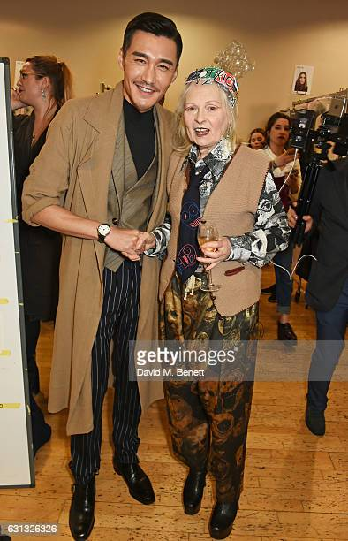 Hu Bing and Dame Vivienne Westwood pose backstage at the Vivienne Westwood show during London Fashion Week Men's January 2017 collections at Seymour...