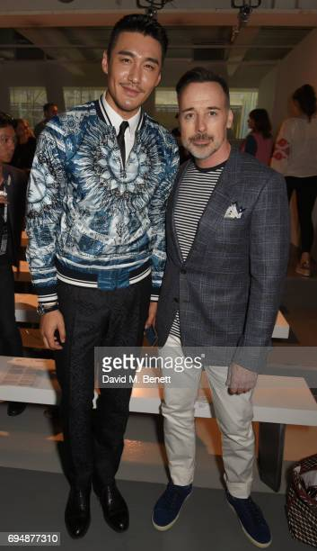 Hu Bing and David Furnish attend the Christopher Raeburn show during the London Fashion Week Men's June 2017 collections on June 11 2017 in London...