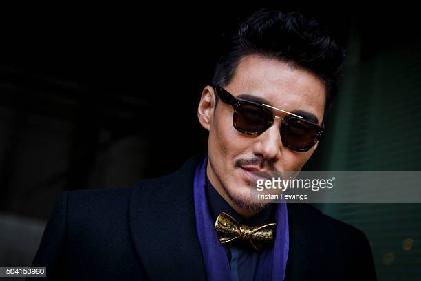 Hu Bing arrives ahead of the ETautz show during The London Collections Men AW16 at BFC Show Space on January 9 2016 in London England