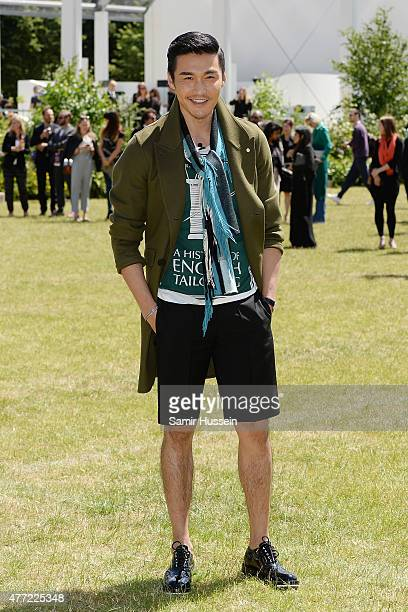 Hu Bing arrives at Burberry Menswear Spring/Summer 2016 show at Kensington Gardens on June 15 2015 in London England