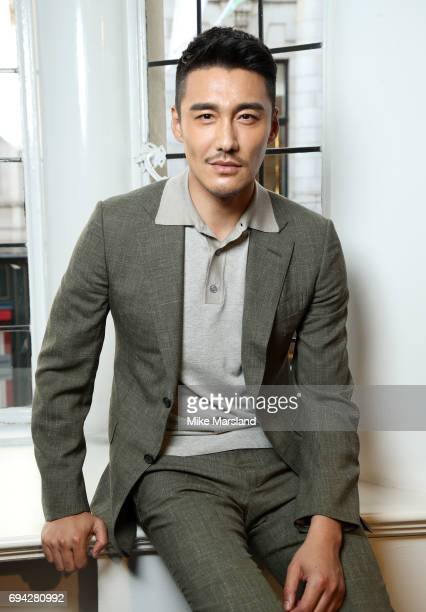 Hu Bing attends London Fashion Week Men's June 2017 collections on June 9 2017 in London England