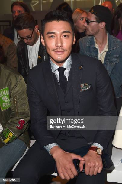 Hu Bing attends the Bobby Abley show during London Fashion Week Men's June 2017 collections on June 12 2017 in London England