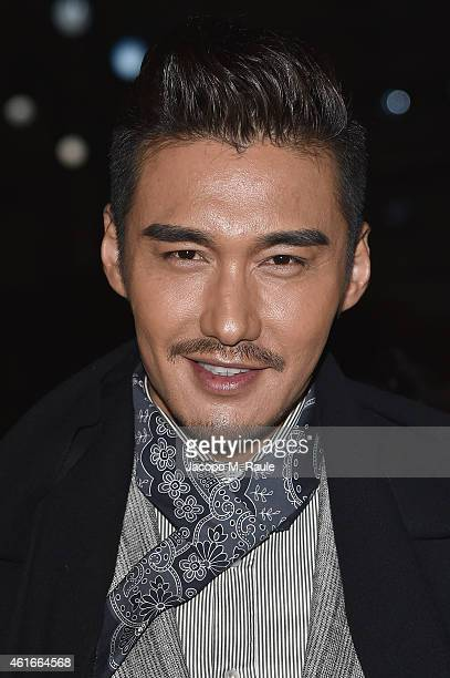 Hu Bing attends the Ermenegildo Zegna Show during the Milan Menswear Fashion Week Fall Winter 2015/2016 on January 17 2015 in Milan Italy