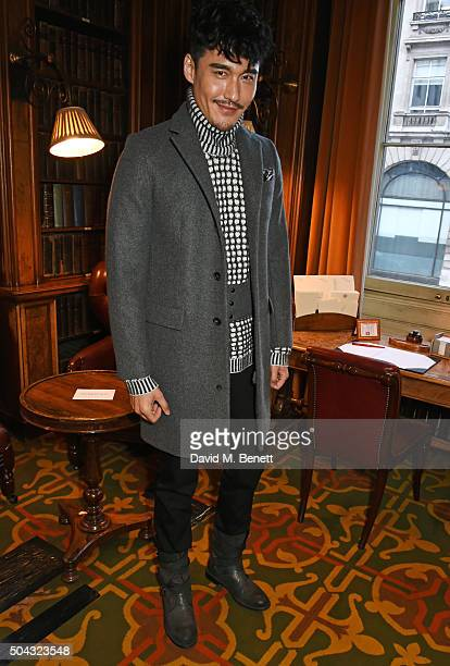 Hu Bing attends the Pringle Of Scotland Menswear Autumn/Winter 2016 show during London Collections Men on January 10 2016 in London England