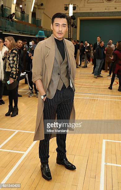 Hu Bing attends the Vivienne Westwood show during London Fashion Week Men's January 2017 collections at on January 9 2017 in London England
