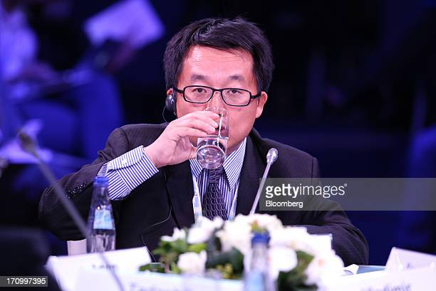 Hu Bing cochief executive officer of RussiaChina Investment Fund drinks during a conference session on the opening day of the St Petersburg...
