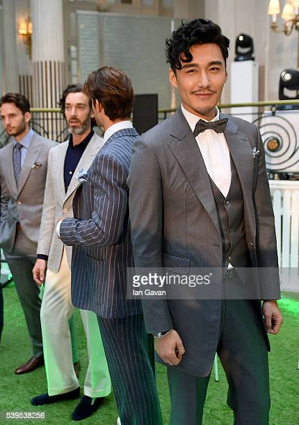 Hu Bing models during the Chester Barrie presentation during The London Collections Men SS17 at The Waldorf Hilton on June 12 2016 in London England