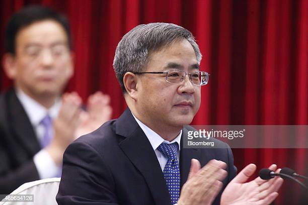 Hu Chunhua Chinese Communist Party secretary of Guangdong Province applauds during a delegation meeting on the sidelines of the third session of the...